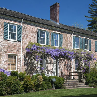 South facade of Macculloch Hall showing the purple wisteria in bloom.